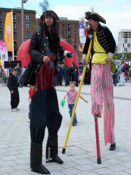 Kris and Pete, pirate stiltwalkers