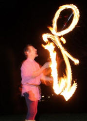 Kris Katchit juggles fire torches